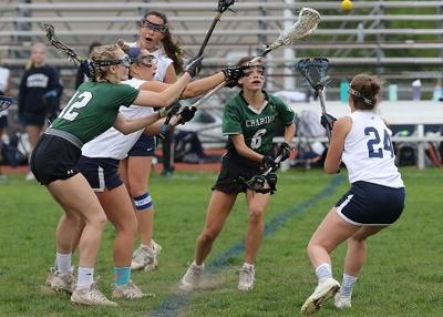 Westerly's Grace Armstrong (24) vies for a loose ball with Chariho's Layne Hart (6) in the Westerly vs Chariho girls' varsity lacrosse game played May 10th, 2019, at Westerly High School's Augeri Field. | Jackie L. Turner, Special to The Sun.