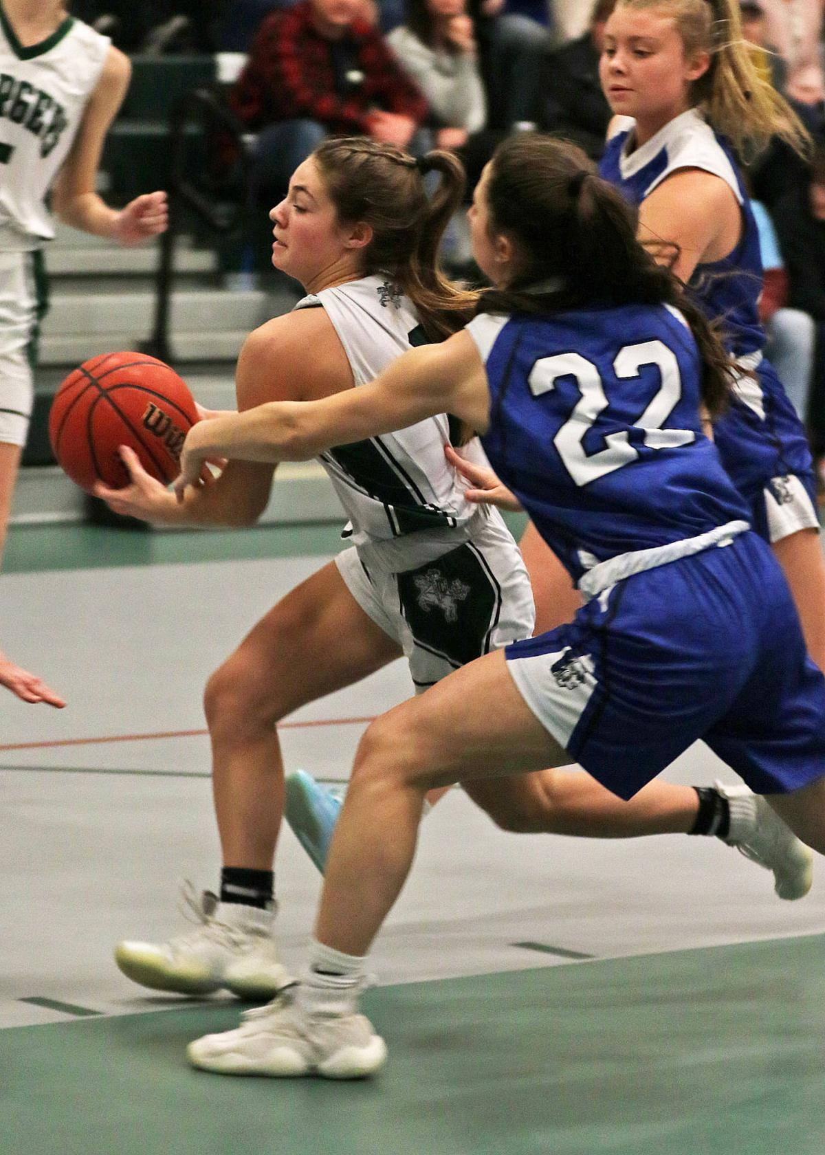 Chariho's Spencer Shiels drives past Scituate's Madison Medbury during Tuesday's Division II game. | Jackie L. Turner, Special to The Sun.