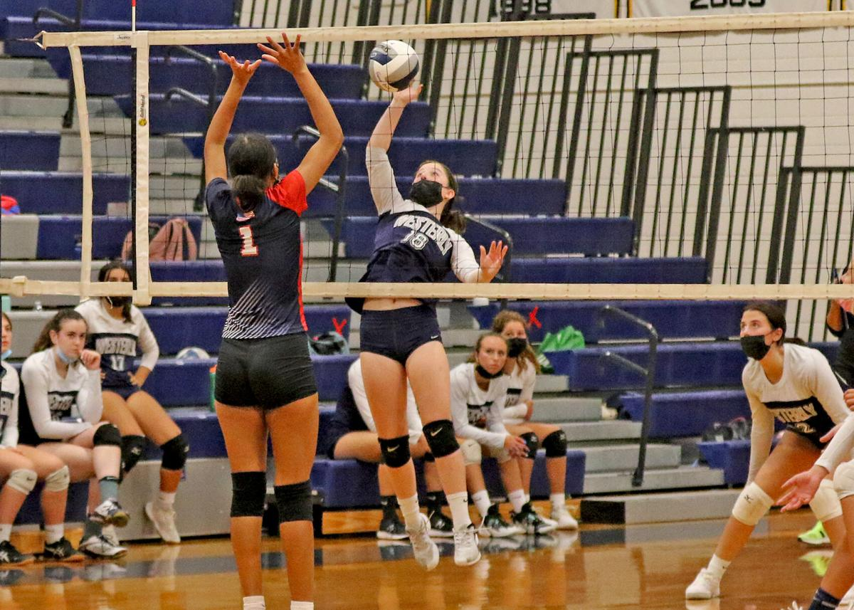 Westerly's Alex Stoerh (18) rises to the net against the defense of Central Falls junior Joana Rodrigues (1) during the second set of the Westerly Bulldogs vs Central Falls Warriors girls' varsity volleyball game played Thursday evening, September 9, 2021 at Westerly High School.   Jackie L. Turner, Special to the Sun.