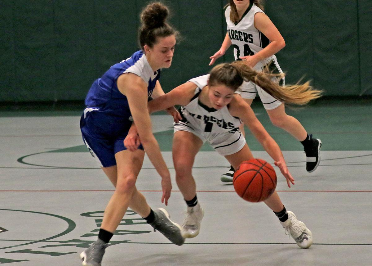 Chariho's Spencer Shiels (1) works to maintain ball control as she drives around Scituate's Rachel Oster during Tuesday's Division II game. | Jackie L. Turner, Special to The Sun.