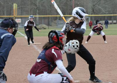 Catcher Haley DelMonaco (6) waits for the pitch while Stonington teammate Margaret Constantine (13) watches closely from third base. The Stonington Bears girls varsity softball team played the Killingly Redmen on Thursday, April 11th, 2019, at Stonington High School. | Jackie L. Turner, Special to The Sun.