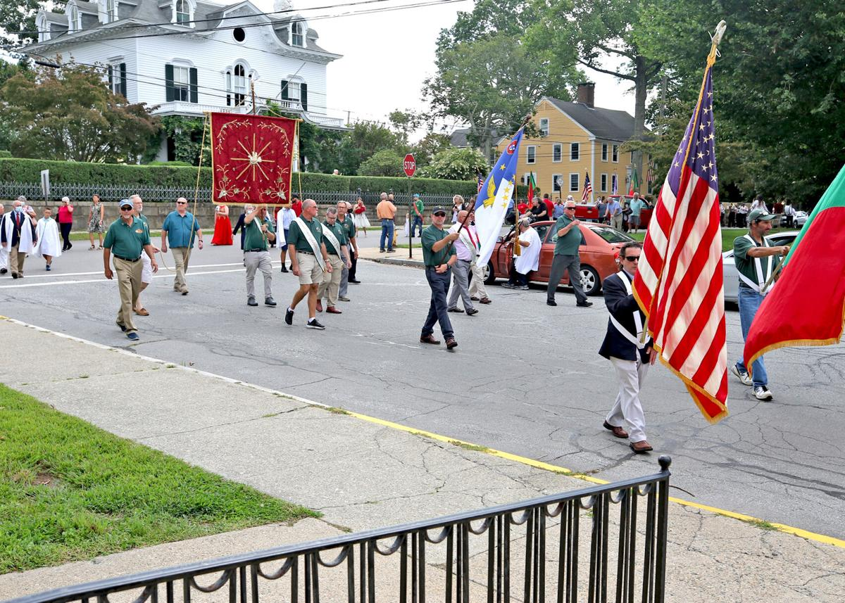 The procession of the Devine Holy Ghost, part of the Portuguese Holy Ghost Society's annual celebration of the Holy Spirit and Third Person of the Trinity, arrives for morning Mass at St. Mary's Roman Catholic Church on Sunday morning, September 5, 2021 in Stonington Borough.   Jackie Turner, Special to The Sun.
