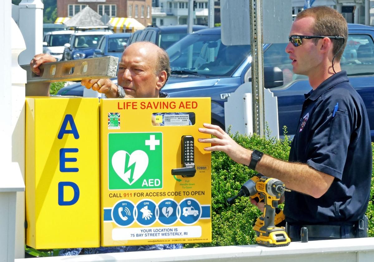 071719 WES AED boxes installed in WH downtown 665.JPG