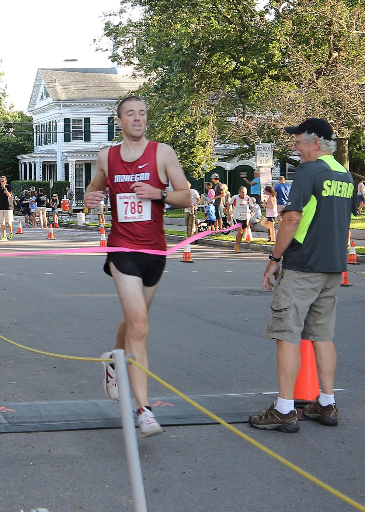 "Across the ""Battle of Stonington 5k"" finish line first overall is North Stonington's Mark Olivier with an official time of 16:23. The 34 year old runner is a two-time winner of the event having won in 2018 with a slightly faster time of 15:59. The event was held Tuesday evening, August 24th, 2019 in Stonington Borough. 