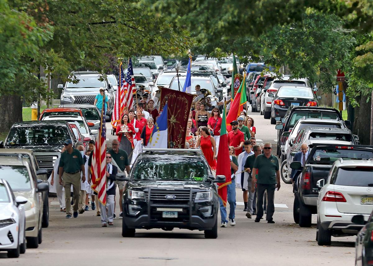 The procession of the Devine Holy Ghost steps off from the Portuguese Holy Ghost Society and makes its way up Main Street toward St. Mary's Roman Catholic Church in Stonington Borough. The march is part of the annual Feast of the Devine Holy Ghost celebration which was held on Sunday, September 5, 2021.   Jackie Turner, Special to The Sun.