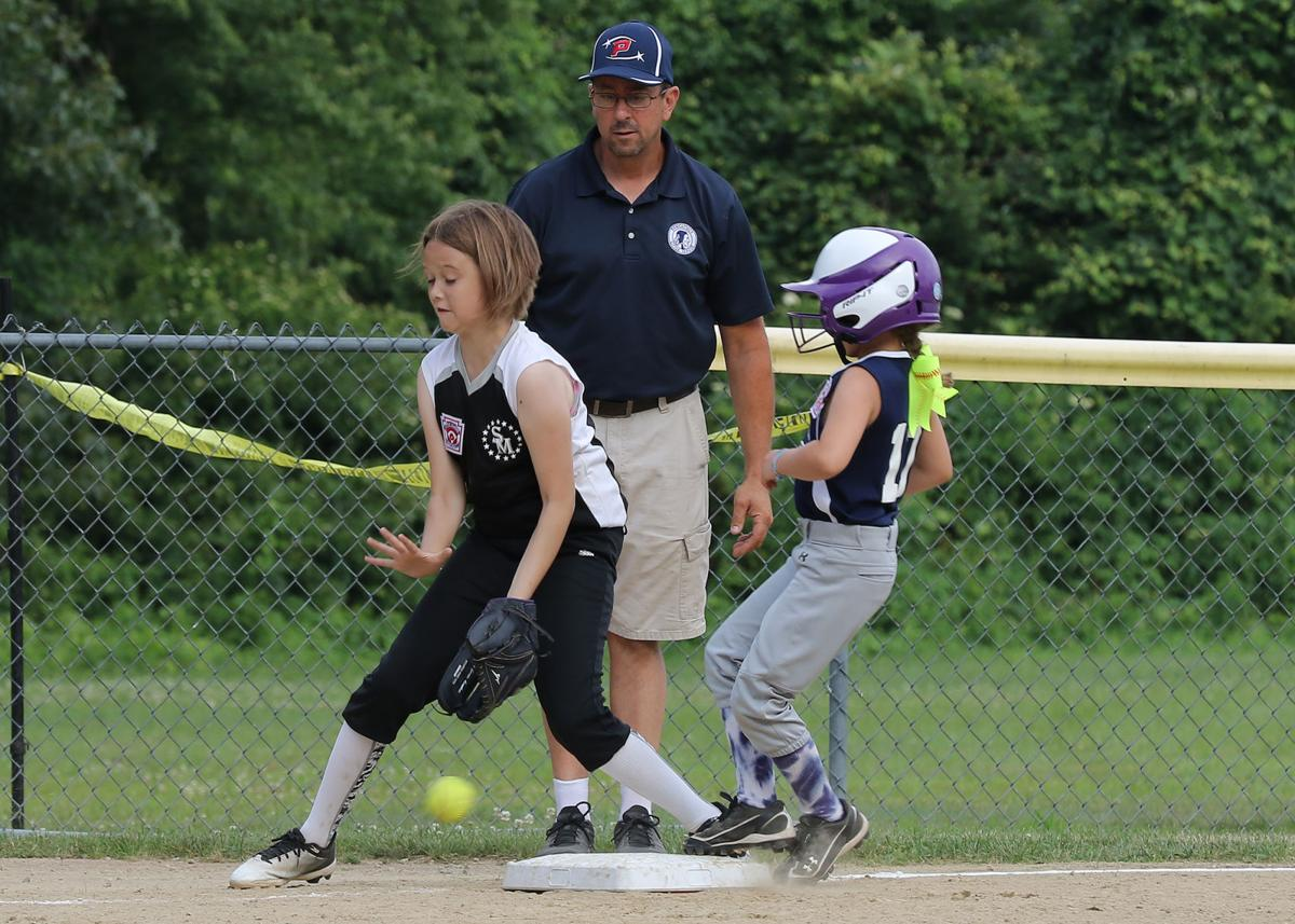 Pawcatuck 10U short-stop Gabby Dunaromme makes her way to third base while coach Art Harvey looks on. The Pawcatuck girls hosted Salem/Montville in the Connecticut District 10 Championship Round Double Elimination game played Friday evening, July 5th, 2019 at the Pawcatuck Little League Complex.   Jackie L. Turner, Special to The Sun.