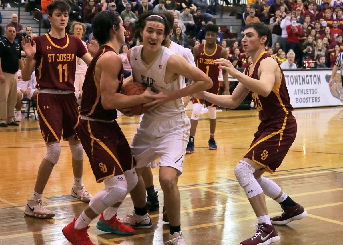 Stonington's Jacob Geary (32) battles for control of the ball against St. Joseph's Stephen Paolini (3) in the Stonington vs St.Joseph boys varsity basketball Division IV quarter final playoffs on Friday evening, March 8th, 2019 at Stonington High School. | Jackie L. Turner, Special to The Sun.