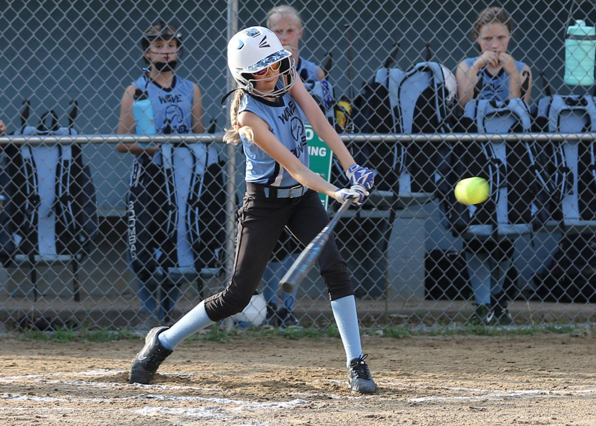 Westerly Wave Runner 12U starting pitcher Lyla Auth connects at bat during the 12U Bash-On-The-Beach softball tournament game against the Guilderland Titans played Friday evening, July 12th, 2019 at Cimalore Field in Westerly. | Jackie L. Turner, Special to The Sun.