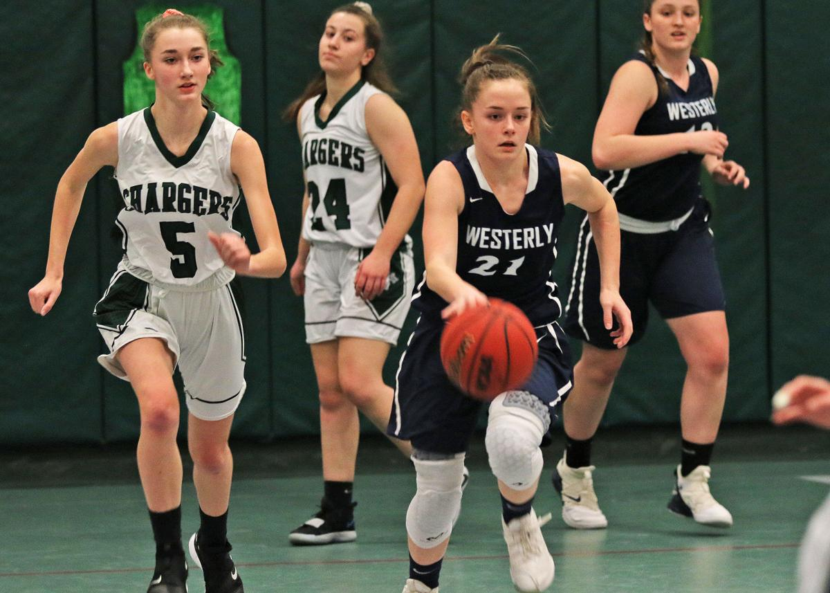 Jaclyn Fusaro (21) starts the ball up-court for Westerly pursued by Chariho's Hanna Dias (5) during the Chariho Chargers vs Westerly Bulldogs girls varsity basketball game played Friday evening, February 21, 2020, at Chariho High School, Wood River Jct., RI. | Jackie L. Turner, Special to The Sun.
