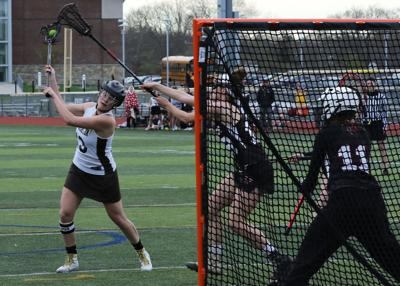 Hannah Lamb (13) winds up to shoot against Fitch goalie Molly Bresnahan (11) during the first half of the Stonington vs Fitch girls varsity lacrosse game played Thursday, April 25th, 2019, at Stonington's Palmer Field. Lamb's shot made it into the net to make the score 3 to 1 Bears with 18:33 left in the half.   Jackie L. Turner, Special to The Sun.