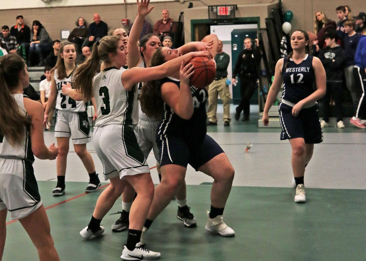 Westerly's Meg Beal (42) tries to get a shot off under heavy pressure from Chariho teammates Kate Powers (3) and Shelby Roode (33) during the first half of the Chariho Chargers vs Westerly Bulldogs girls varsity basketball game played Friday evening, February 21, 2020, at Chariho High School, Wood River Jct., RI. Westerly's Alexa Beal (12) looks on. | Jackie L. Turner, Special to The Sun.