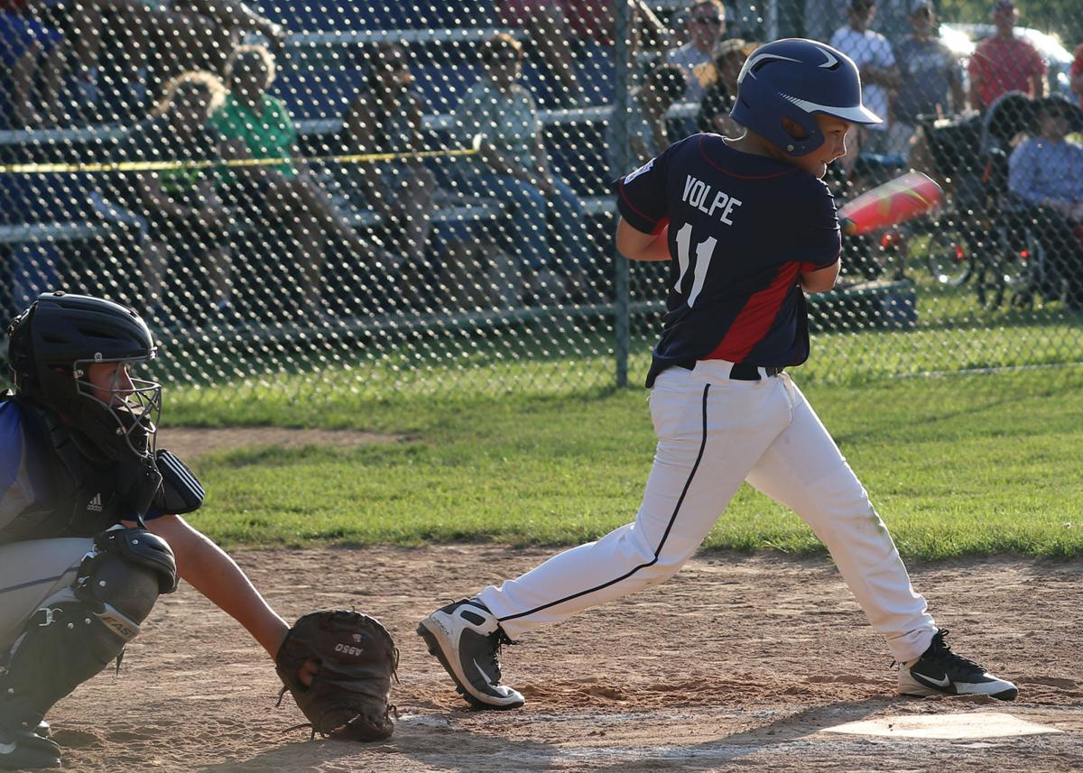 Mystic first baseman Chase Volpe connects for a base hit in the Mystic vs Waterford Division 10 Championship little league title game played Monday evening, July 8th, 2019, at Rossie Field in Mystic. | Jackie L. Turner, Special to The Sun.