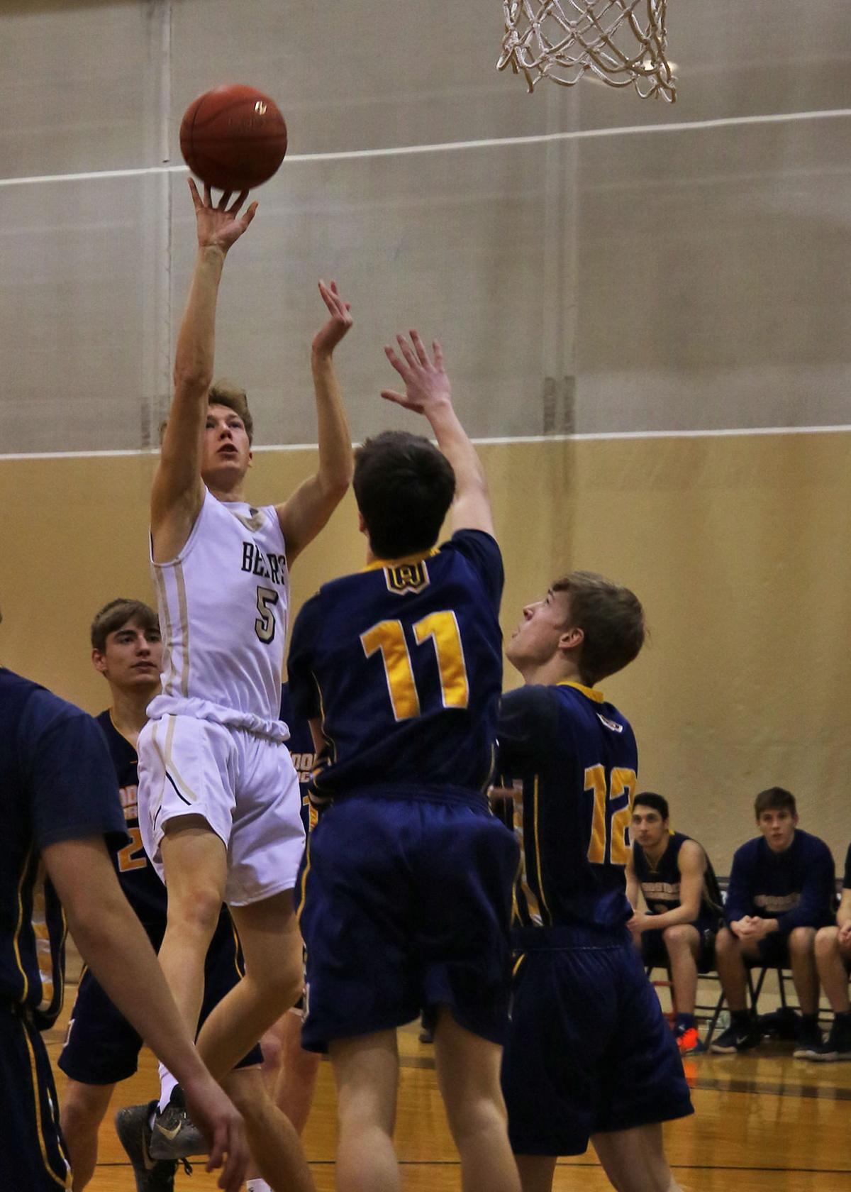 Stonington's Zach Scott (5) shoots over the reach of Woodstock Academy's Nick Bedard (11) during the Stonington Bears vs Woodstock Academy Centaurs boys varsity basket ball game played Friday evening, February 14, 2020 at Stonington High School, Pawcatuck, CT. | Jackie L. Turner, Special to The Sun.