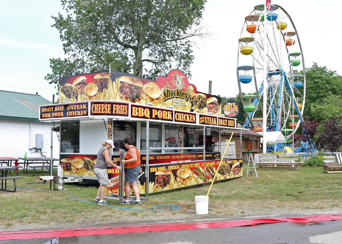 The folks from Shockley's were on hand Monday afternoon, July 8th, 2019, setting up for the opening of the 54th Annual North Stonington Agricultural Fair, scheduled to run Thursday, July 11th, through Sunday, July 14th. | Jackie Turner, Special to The Sun.
