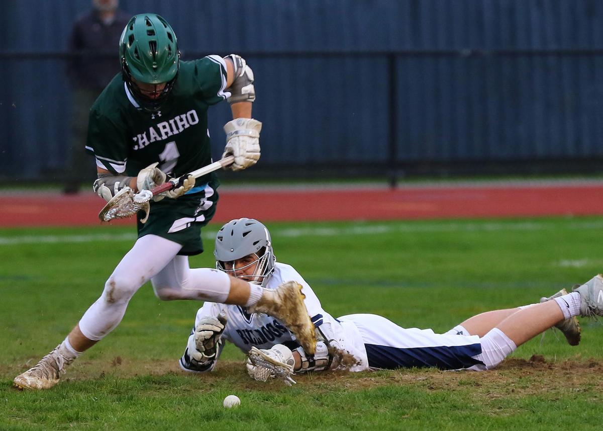 Chariho's Luke Mead (1) goes after a loose ball while Madigan Hiltz (20) goes down after the face-off. The Westerly Bulldogs boys' varsity lacrosse team hosted the Chariho Chargers on May 1st, 2019, at Westerly High School's Augeri Field. | Jackie L. Turner, Special to The Sun.
