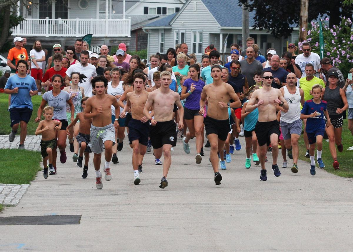 Runners of all ages make their way up Misquamicut's Elmwood Avenue after leaving the starting line of the Tom McCoy Family Fun Run combined 1-mile and 5k foot-races. The event, held Wednesday evening, August 7th, 2019, is the last regular-season race in the Tom McCoy Family Fun Run series. A final 5k event and an awards hand-out are scheduled for Wednesday, April 14th. | Jackie L. Turner, Special to The Sun.