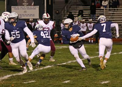 Westerly's Anthony Durante (3) receives a handoff from teammate Rocco Cillino (7) while Trent Lamb (55) and Derek Mason (42) block during the Westerly vs Woonsocket boys' varsity football DIV-II playoff game on Friday evening, November 8th, 2019, at Westerly High School's Augeri Field, Westerly, RI. | Jackie L. Turner, Special to The Sun.