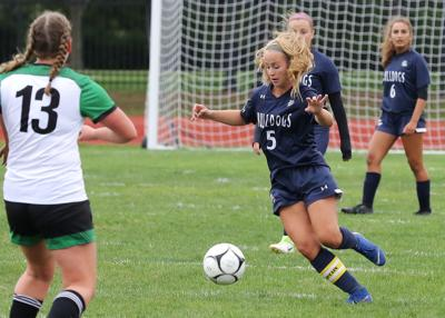 Westerly's Mikayla Sousa (5) works the ball upfield while Lincoln's Riley Specht (13) defends. The Westerly Bulldogs girls' varsity soccer team hosted the Lincoln Lynx on Friday afternoon, September 6th, 2019 at Westerly High School's Augeri Field. | Jackie L. Turner, Special to The Sun.