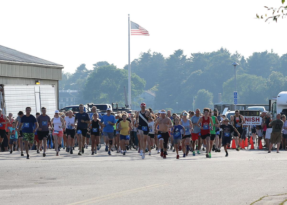 Participants of the St. Mary's Blessing of the Fleet 5k Run, held Thursday, July 25th, 2019 in Stonington Borough, leave the starting line located adjacent to the Stonington Town Docks. | Jackie L. Turner, Special to The Sun.
