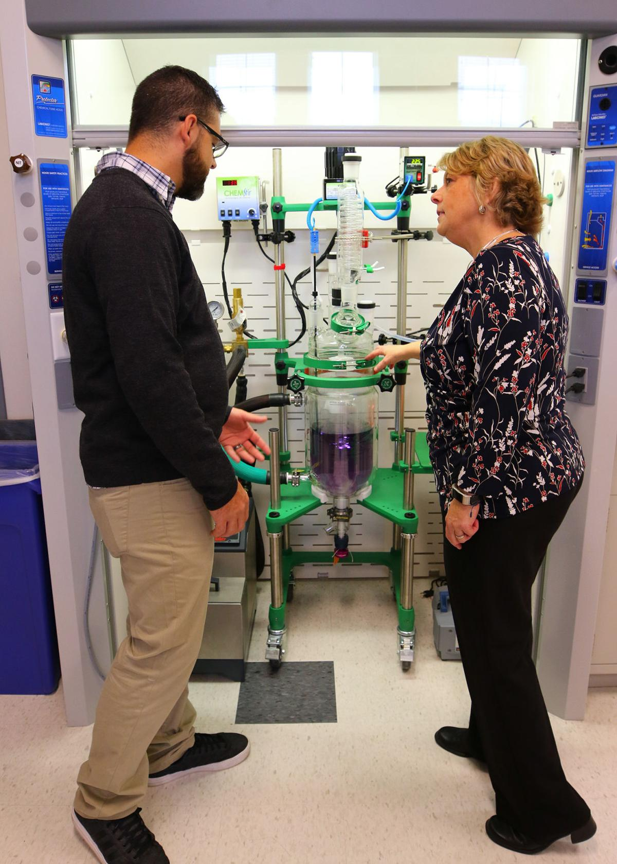 Students Greg Viveiros and Jennifer Brown discuss the new chemical reactor equipment in the Process Technologies Laboratory at the Westerly Education Center on Friendship Street. This lab and a biological sciences lab were dedicated at a ribbon cutting ceremony held Friday morning, November 16th, 2018. | Jackie Turner, Special to The Sun.