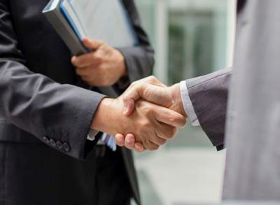 standing business handshake