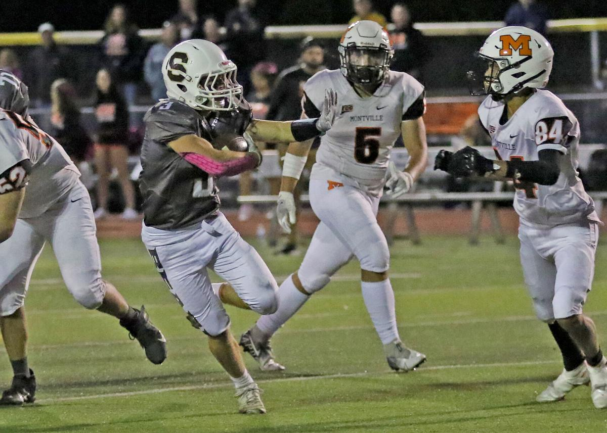 Matt Castagliuolo (3) carries the ball for Stonington during the first half of the Stonington vs Montville Division-S varsity football game played Friday evening, October 1, 2021, at Stonington High School's Palmer Field, Pawcatuck, CT.   Jackie L. Turner, Special to The Sun.
