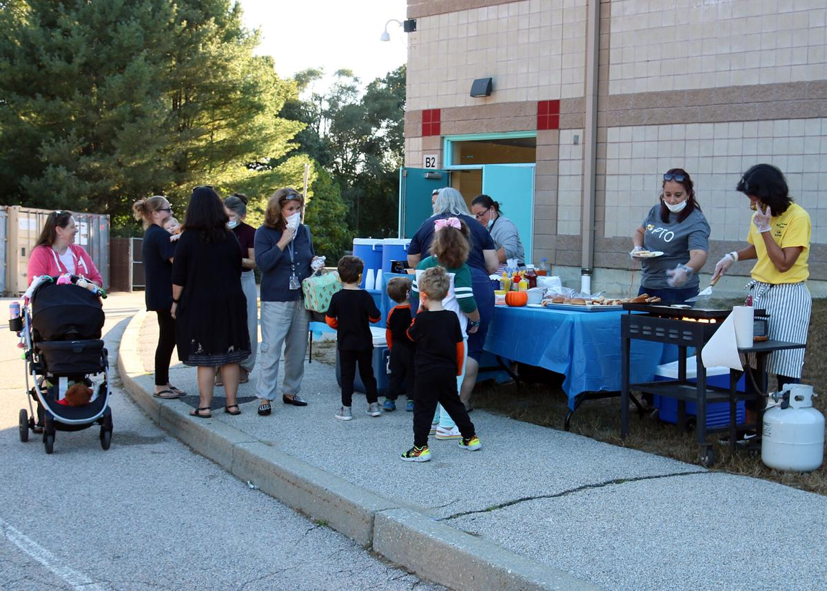 The chow line was very busy at the Springbrook Elementary School's First Annual Fall Fest. No tummy was left on empty after this delicious dinner. Springbrook Elementary School First Annual Fall Fest. Thursday, October 7, 2021, Springbrook Elementary School, Westerly, RI.   Karen Stellmaker, Special to The Sun.