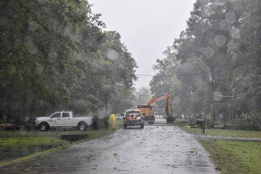 WBR Parish Department of Public Works equipment move a downed tree from a street near Erwinville.