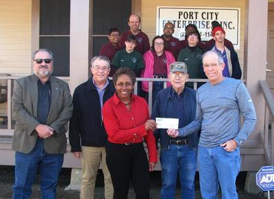 Port City Enterprises recieves donation from the Knights of Columbus