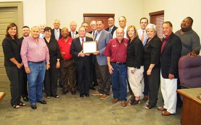Mayor Ed Reeves and Board of Selectmen celebrate Plaquemine Bank & Trust's 50th Anniversary