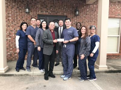 Bell Family Chiropractic donates to WPD toy drive