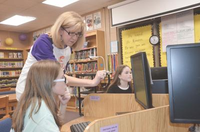Eclectic Middle School library media specialist Amy Harrell