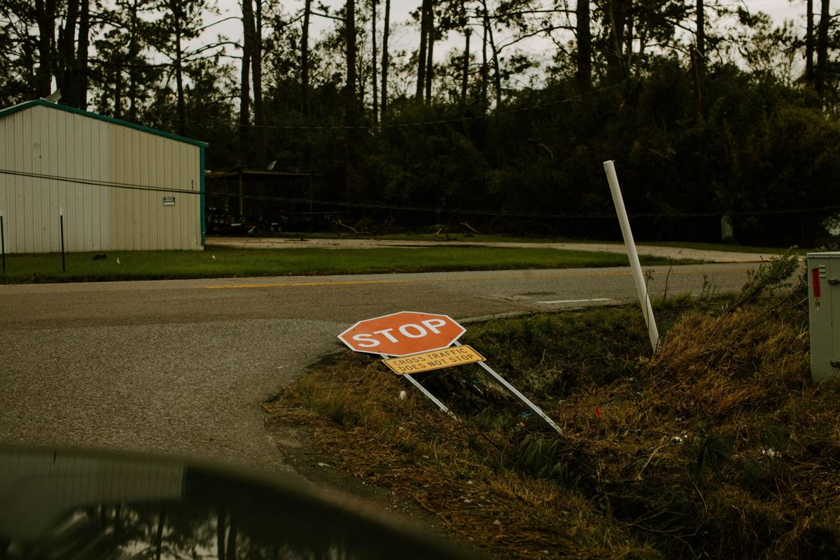 Source: Engel captured a stop sign blown down from the hurricane.