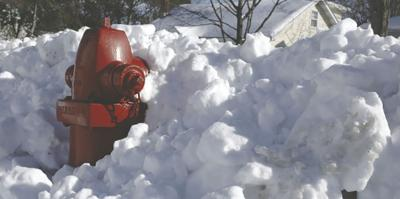 Fire Hydrant Covered in Snow