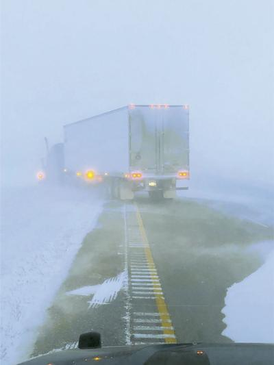 Semi-Truck Stuck in Ditch During White Out Conditions