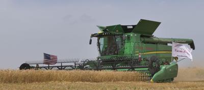 Farm Rescue Combine in Field Taking off Crop