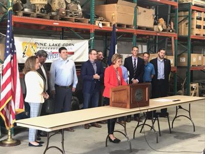 Gov. Kim Reynolds signs Senate File 2403