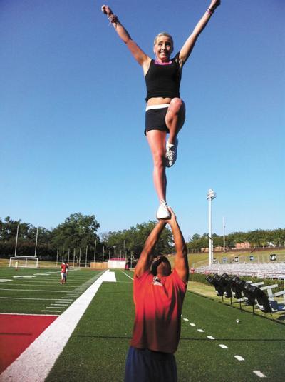 Ex-football player turns to cheerleading