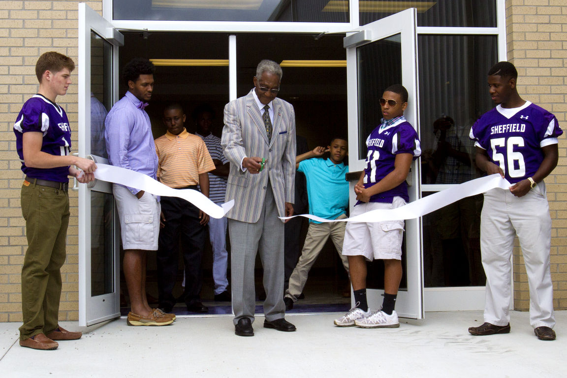 Former Sheffield coach Milton Franklin cuts the ribbon on the school's newly renovated gym and multi-purpose building Sunday afternoon in Sheffield.