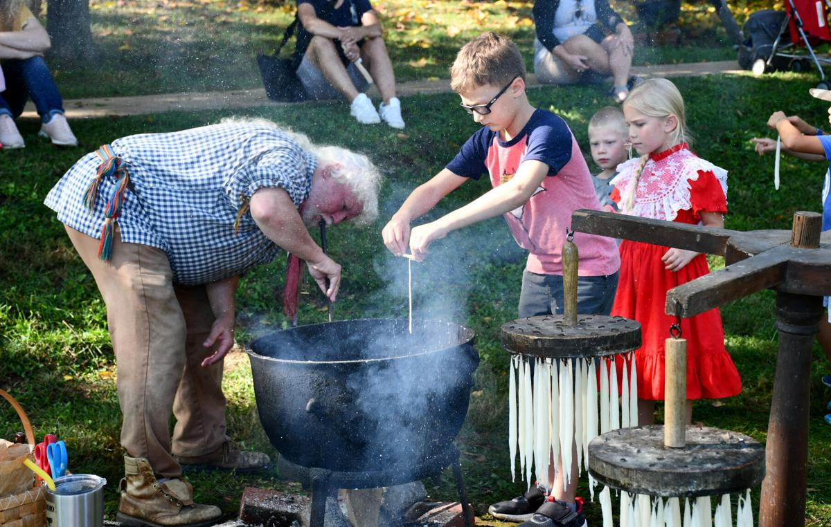 Candle-dipping at Rocky Mount State Historic Site's Harvest Festival 2021