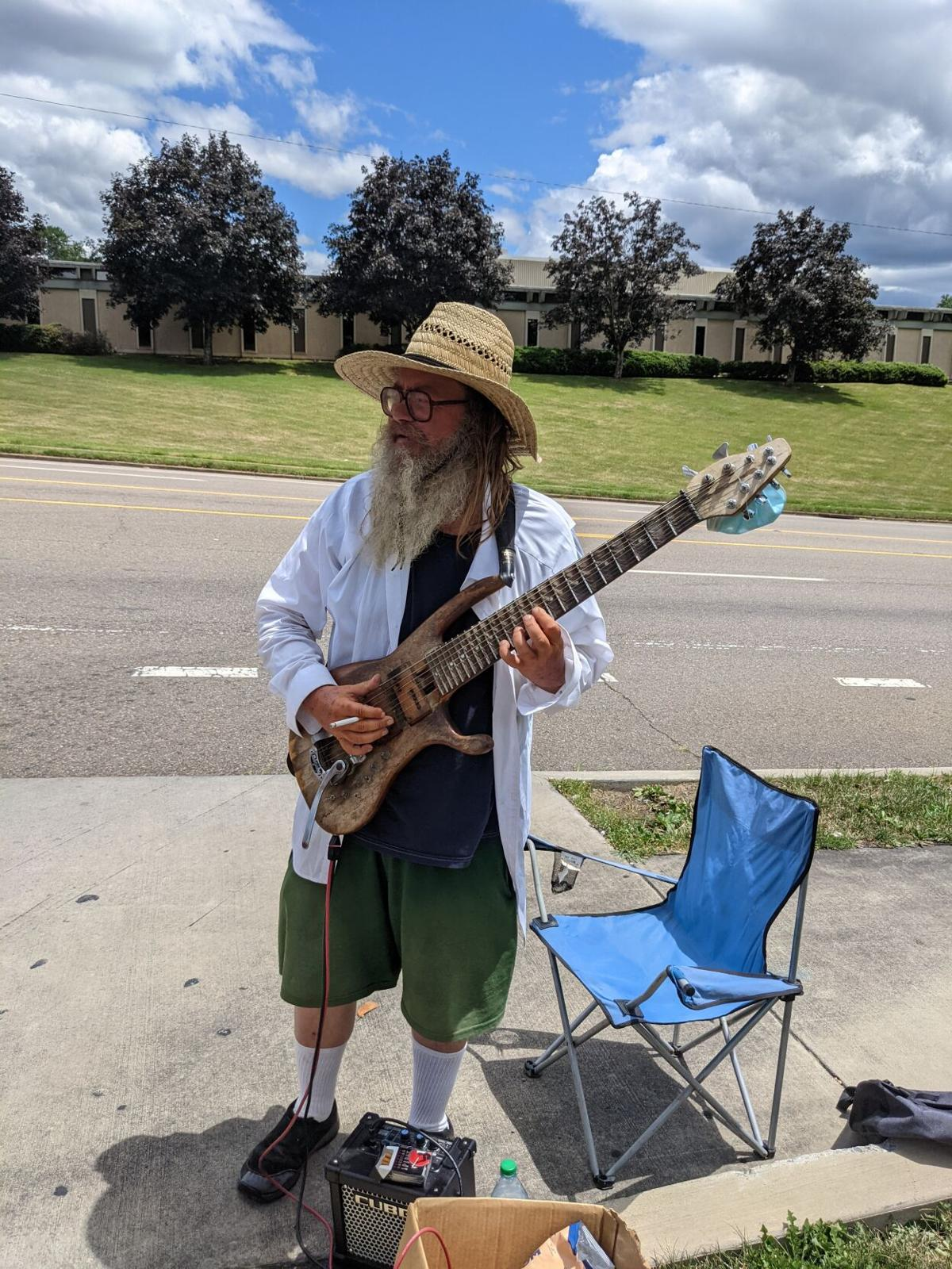 Richard Scott plays guitar on Lynn Garden