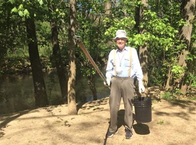 """Jim Sell trying to """"catch"""" trash on the Greenbelt"""