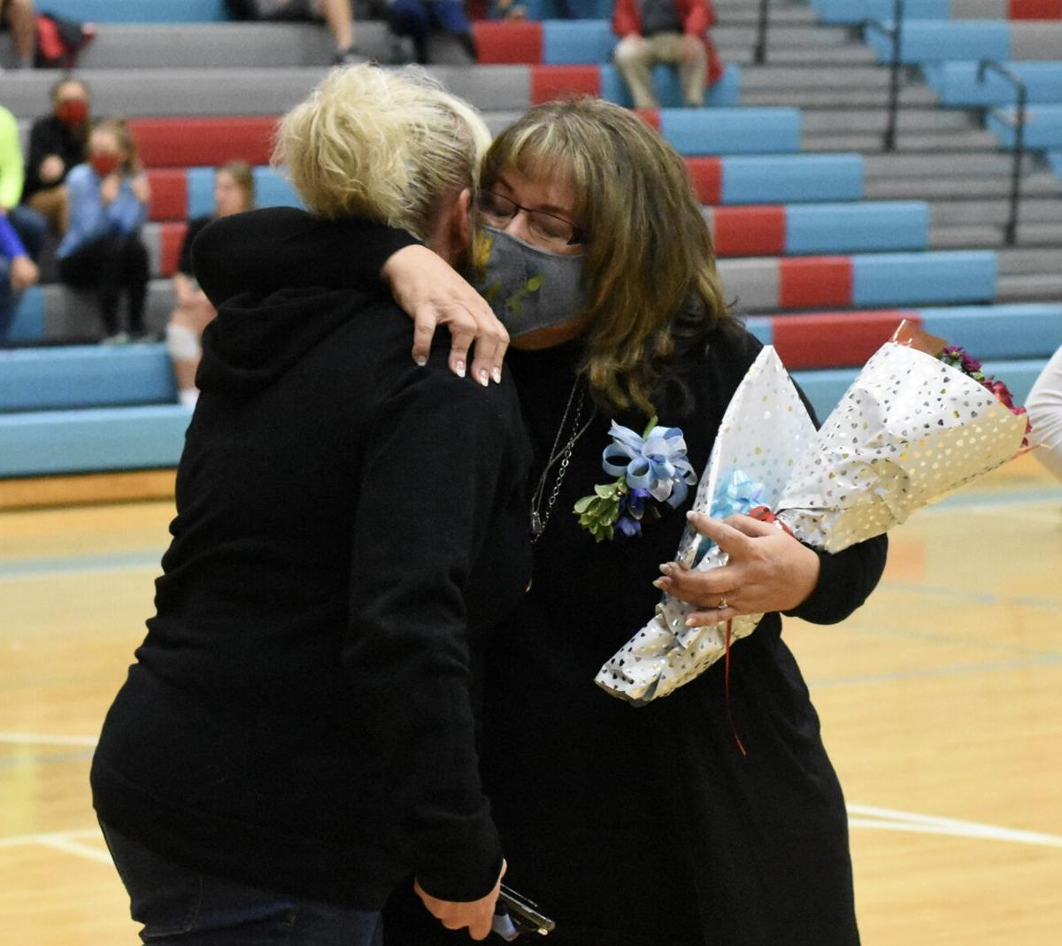 Sherry Hooks and Wendy Ratliff share a hug