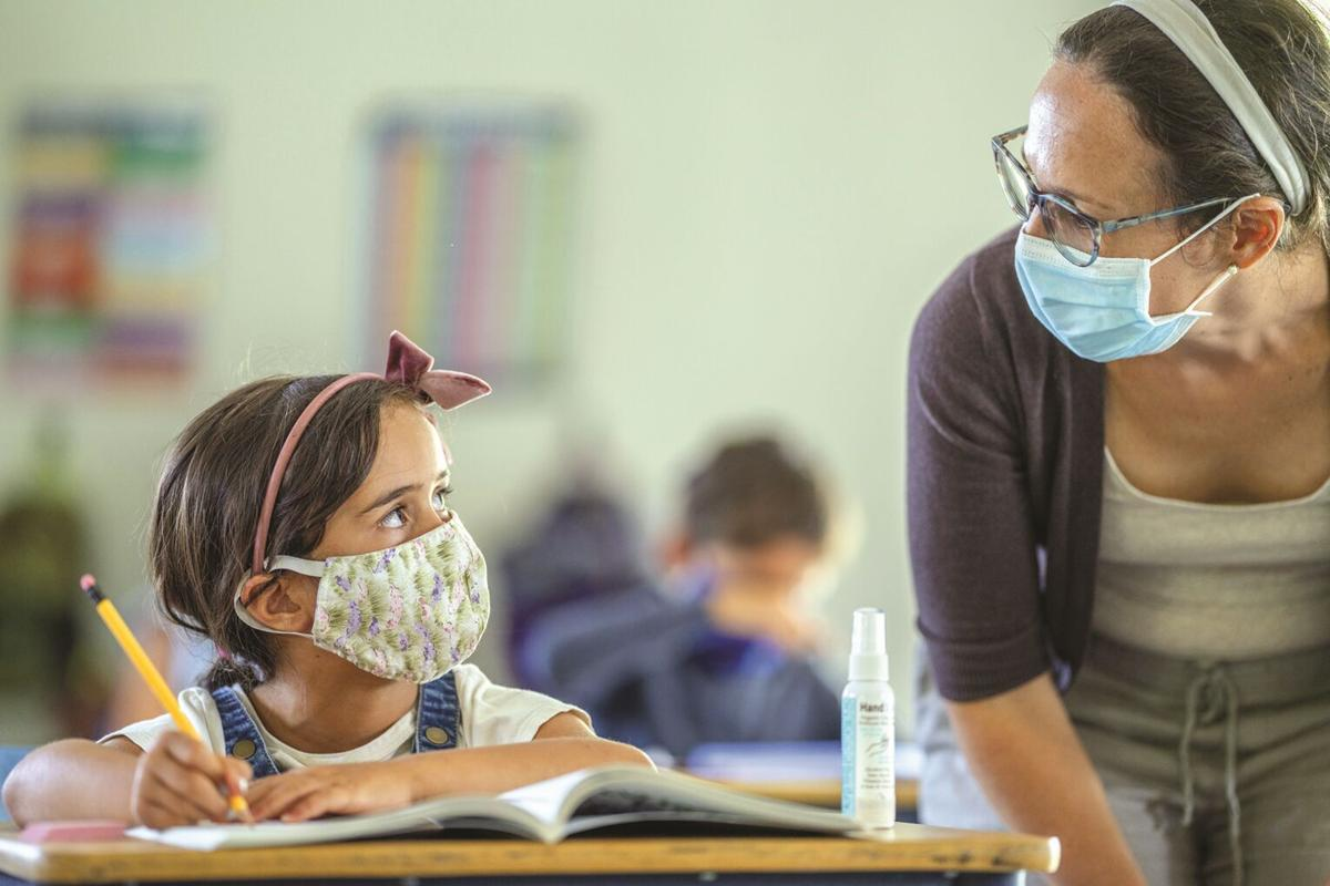 Masked student and teacher
