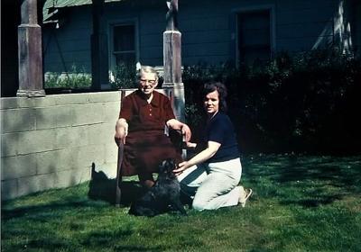 Mrs. Nancy Fraysier, Alex the dog, and Wanda Osborne, Sullivan Court, circa 1976