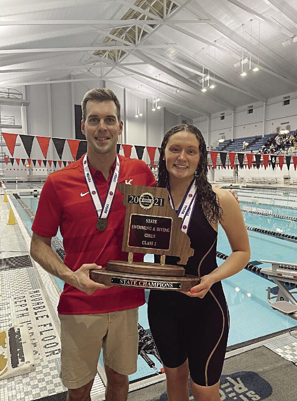 KHS Girls Swim Champs - Coach Matt Beasley and senior Ella Pearl with trophy.tif