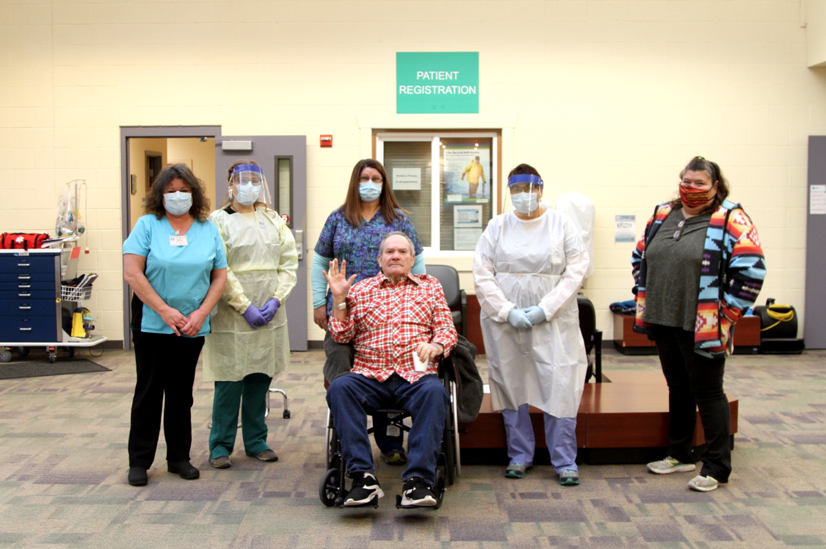 Colville Tribal elder Mike Seyler, seated, with nursing staff from the Colville Service Unit - Indian Health Service and Colville Tribal Convalescent Center.