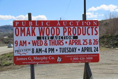 The auction sign outside the Omak plywood and veneer mill advertising an upcoming auction.