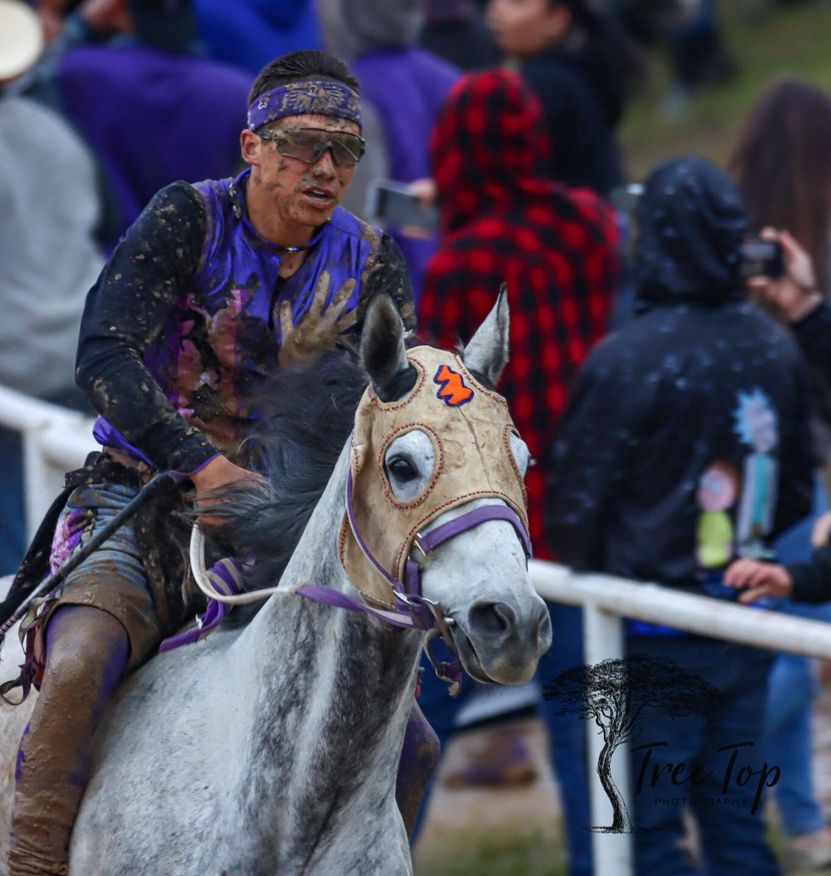 Colville tribal member Scott Abrahamson gets muddied up as he rides in the championship race of the International Championships in Oklahoma (May 27-31)