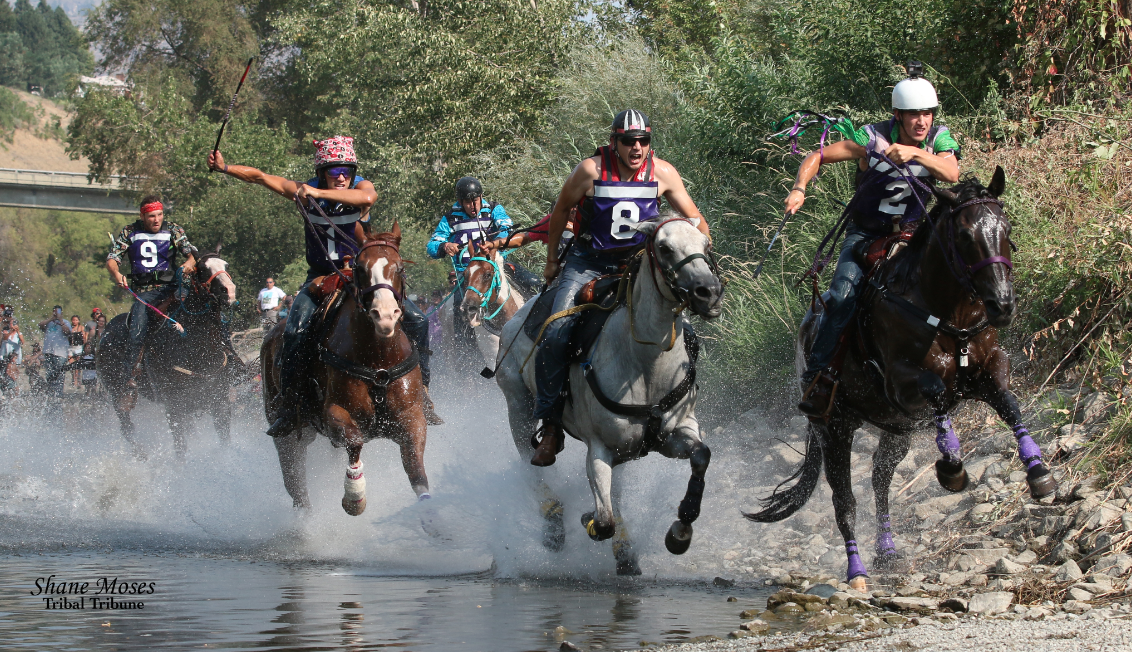 Riley Prescott (#2) and Black Shay are the first ones out of the Okanogan River as they lead Oliver Pakootas (#8) and Scott Abrahamson (#1) on Sunday afternoon